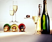Various champagne bottles, champagne glasses and corks