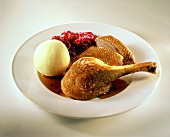 Goose with potato dumpling and red cabbage