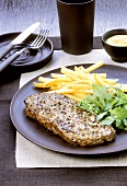 Peppered steak with chips, rocket and mustard