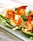 Shrimps and diced mozzarella on artichoke leaves