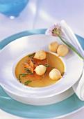 Vegetable bouillon with mini cream puffs
