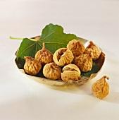 Dried fig on leaf in silver bowl