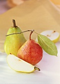 Pears with stalk and leaf and wedge of pear