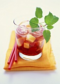 Fruit tea with fresh fruit and lemon balm