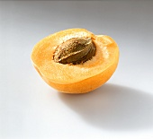 Half apricot with stone