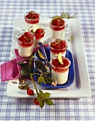 Cream mousse with raspberries in Grappa, in glasses on tray