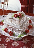 Festive two-tiered heart-shaped cake with marzipan roses