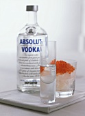 Vodka in glass and bottle with caviare
