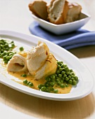 Plaice rolls with saffron sauce and peas