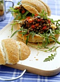 Bread roll with mince and rocket