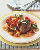 Lamb steaks on tomatoes with rosemary and basil
