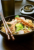 Asian noodle salad with chicken, broccoli and radishes