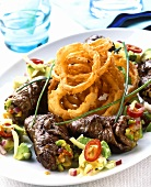 Beef roulades with deep-fried onion rings