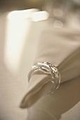 White napkin with elegant napkin ring