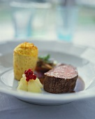 Beef fillet with root vegetable muffin and apple compote