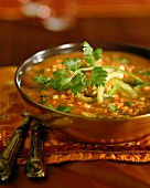 Lentil soup with strips of pepper and parsley