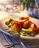 Goat's cheese wrapped in bacon with potatoes and broad beans