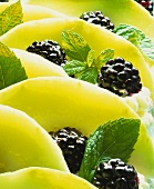 Minted quark cake with blackberries & melon (close-up)