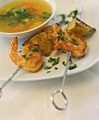 Fish soup with shrimp kebab