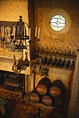 French restaurant with open fire, wine barrels and bottles