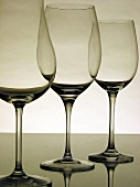 Three empty wine glasses