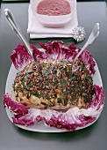Roast with spinach and pine nuts on radicchio