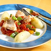 Fish with pepper and tomato sauce and potatoes