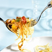 Spaghetti with mince & vegetable ragout on fork and spoon