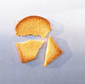 A slice of zwieback (rusk), broken into three
