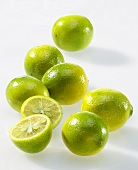 Several limequats, one halved