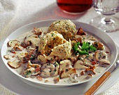 Cep ragout with bread dumpling; red wine