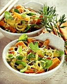 Fried carrots with coriander and glass noodles cooked in wok