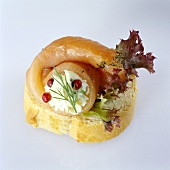 Canapé with salmon, with lettuce garnish