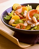 Potato and celery salad with beans and Tyrolean bacon