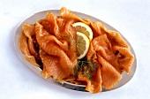Smoked salmon, garnished with lemon and dill
