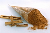 Ground cinnamon in cellophane bag and cinnamon sticks