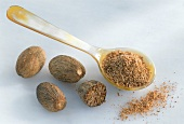 Nutmegs and a spoonful of ground nutmeg