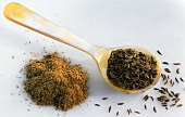 Caraway seed on spoon and ground caraway