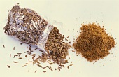 Caraway in cellophane bag and ground caraway
