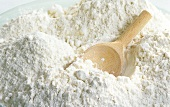 Unbleached wheat flour with wooden scoop