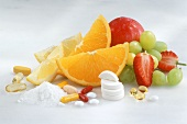 Fresh fruit, vitamin tablets and powder