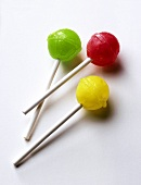 Three coloured lollipops