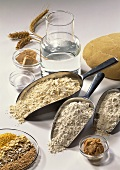 Still life: ingredients for baking bread (flour, yeast, water)