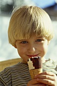 Small boy eating ice cream