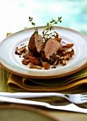 Veal fillet in cocoa on rhubarb, chanterelles & shallots