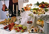 Sumptuous party buffet with champagne and waiter