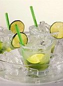 Caipirinha in cooler with ice cubes