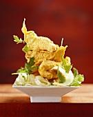 Catfish escalope in tempura batter on lettuce