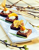 Chocolate puffed rice slices with lime sauce and fruit