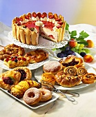 Buffet with small cakes and strawberry gateau
